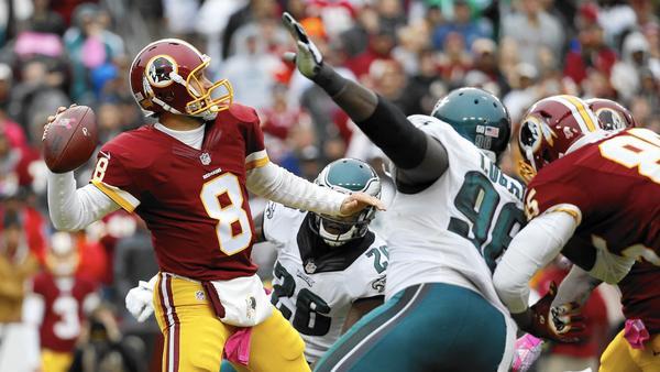 Match solide de Kirk Cousins. 3è défaite pour les Eagles. (AP)