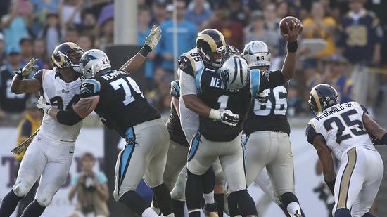 Malgré les coups, Cam Newton et les Panthers s'en sortent (USA Today)