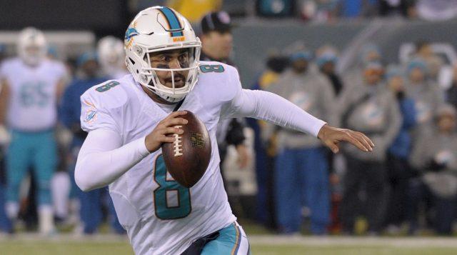 Matt Moore a prouvé qu'il pouvait garder les Dolphins compétitifs (AP)